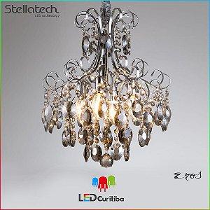 LUSTRE STELLA ÉROS (38cm) - 127v / 220v 4xE12 - 383x483x1500x120 (mm) Cromado com cristais em conhaque