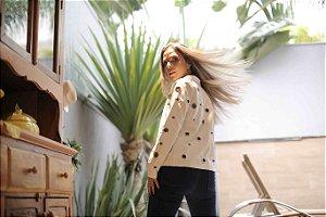 Jaqueta de couro ecológico com ilhós