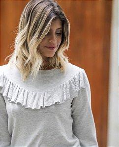 Blusa de tricot com babados em V