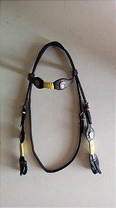 Cabeçada em couro com aplique e trança amarela