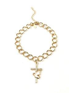 Pulseira  folheada a ouro com  pingente de cruz cravejado de zirconia