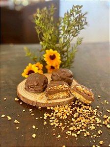 Agnus cobertura de chocolate e recheado com avelã Granel - 100 gr