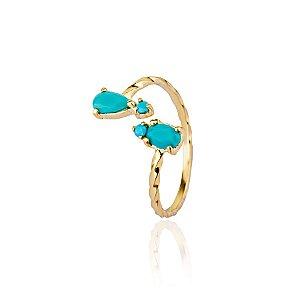Anel semijoia de falange, com aro torcido e cristais cravejados nas pontas, banhado em ouro 18k