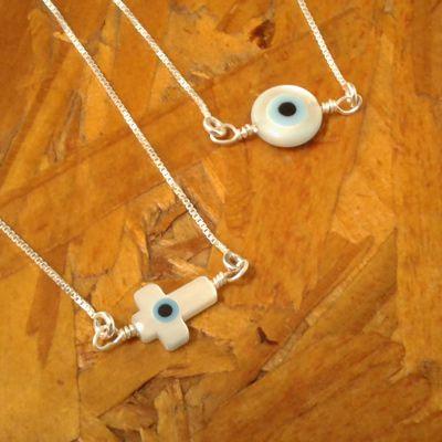 Escapulario cruz e olho grego