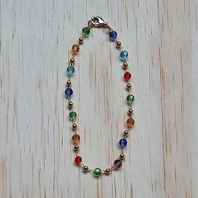 Pulseira dourada de cristais coloridos