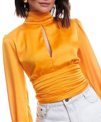 Blusa cintilante detalhe decote