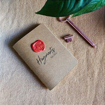 Bloco notas Hogwarts com selo