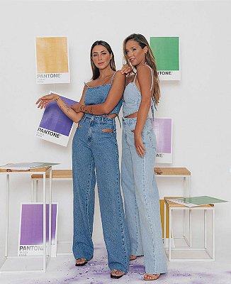 Calça jeans vazada - alcance