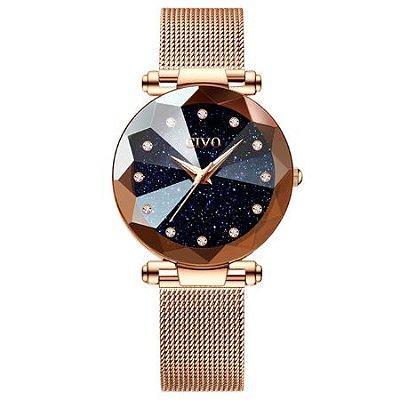 Relógio feminino dourado com pulseira de imã