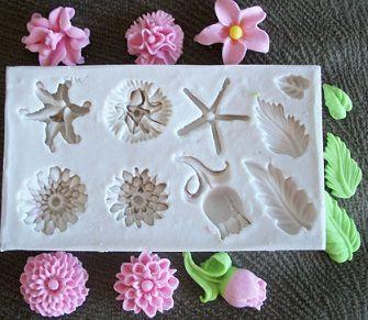 Molde de silicone Flores p/ docinho  (2,2 a 1,2cm)