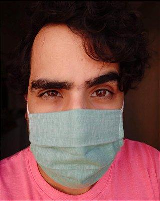 Máscara de tecido verde claro