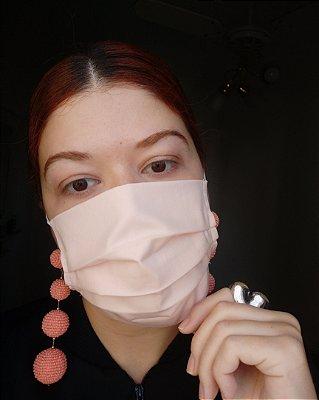 Máscara de tecido rosa claro