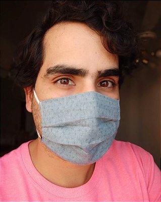 Máscara de tecido azul chambray