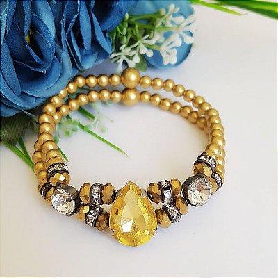 Pulseira dourada com pedra gota