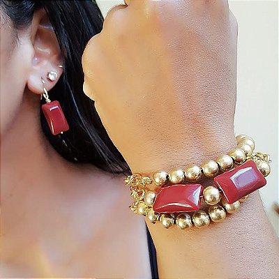 Conjunto de pulseira e brincos dourado e vermelho