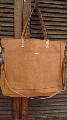 Bolsa de tecido com alças de couro