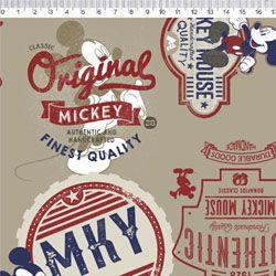 Tecido Tricoline Mickey Mouse Label - Coleção Disney - Fundo Bege - Preço de 50 cm x 150 cm