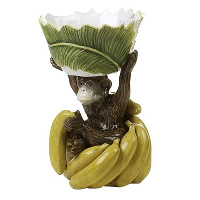 Macaco na penca de banana com bowl na cabeça