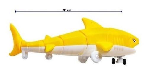 Tubarão Shark Bate Volta Articulado Brinquedo Musical