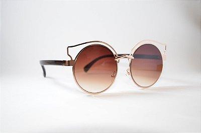 Óculos de Sol Feminino Redondo com detalhes Dourado lente degradê marron