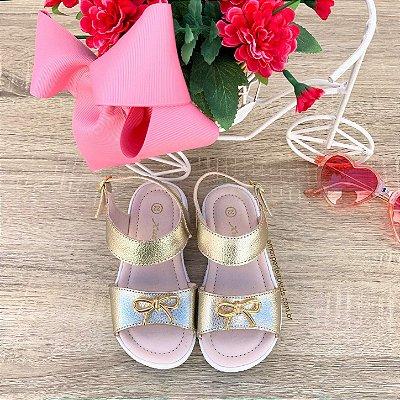 Sandália infantil dourada Xuá Xuá de lacinho em metal Tam 18