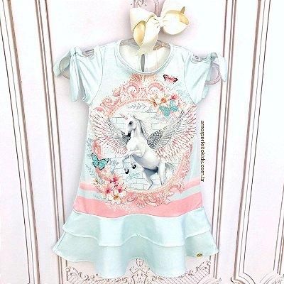 Vestido infantil Petit Cherie casual unicónio com brilho azul claro