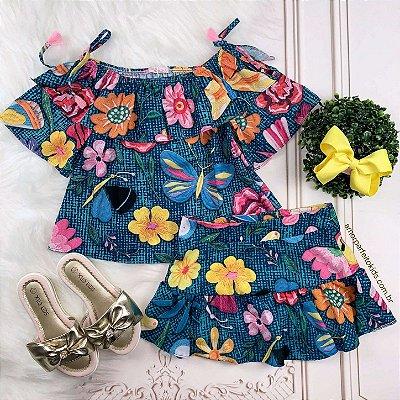 Conjunto infantil Mon Sucré blusa ciganinha floral e borboleta saia azul Tam 12
