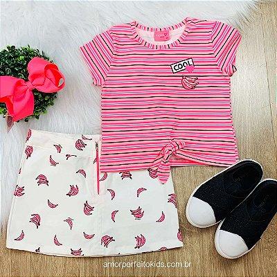Conjunto infantil Momi blusa listrada neon com saia bananas branca e pink Tam 2