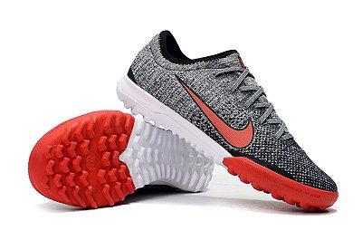 Chuteira Nike Mercurial VaporX VII Pro IC Society Neymar Junior 2019 Cinza e Vermelho