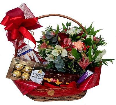 Cesta chá, chocolate e flores
