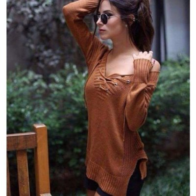Blusa de trico com ilhos