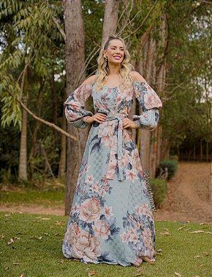 Vestido de festa floral, com saia fluida e manga longa