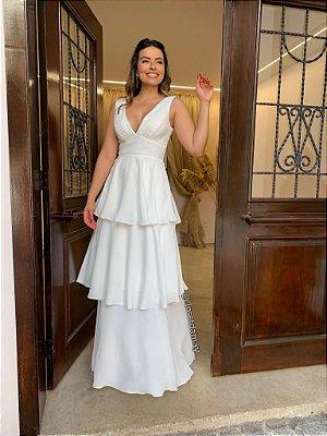 Vestido de noiva dois em um, com babados na saia e decote em V