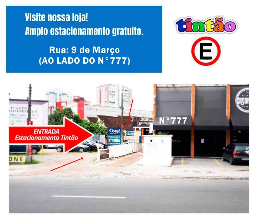 Indicação da entrada no estacionamento Tintão