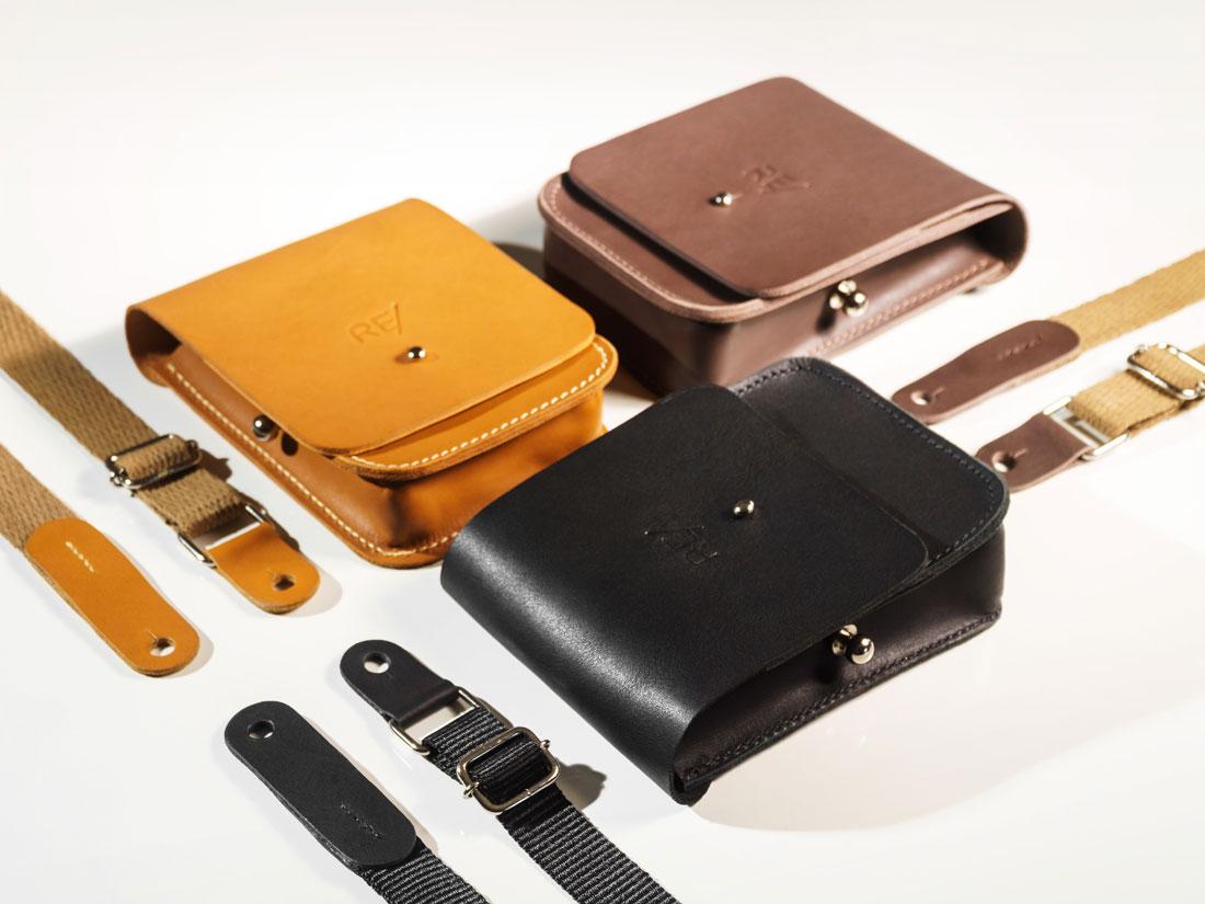 Cube Smartbag nas cores caramelo, marrom café e preto, com alças em algodão e nylon.