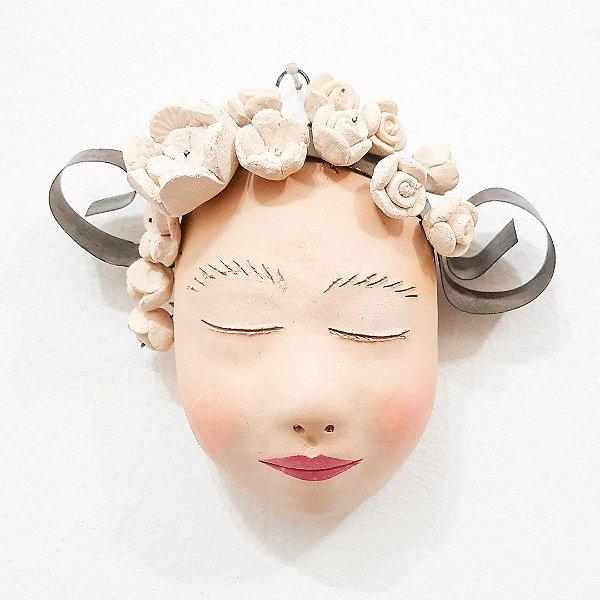 Máscara de mulher em cerâmica para parede