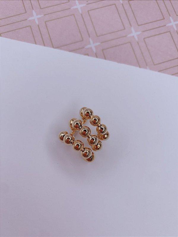 Piercing fake dourado de bolinha