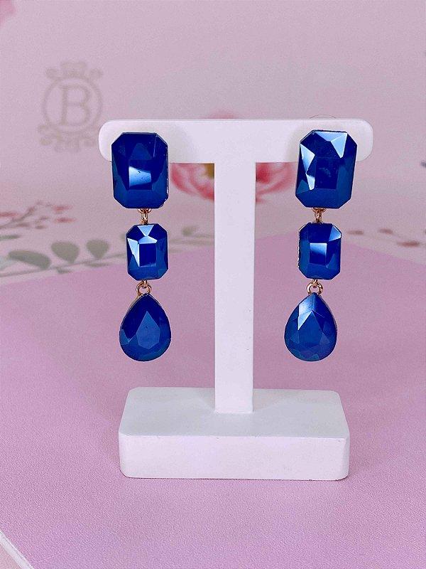Brinco dourado com 2 pedras quadradas e uma gota azul royal