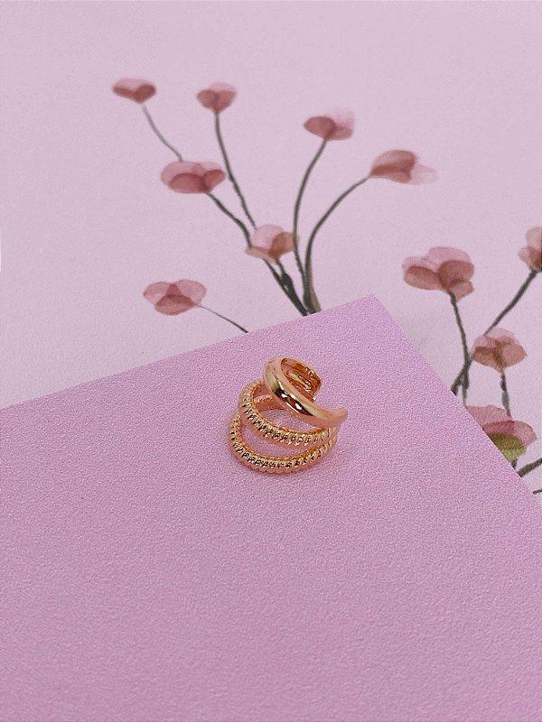 Piercing fake dourado com detalhes riscados