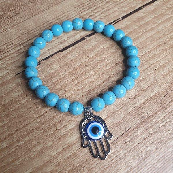 Pulseira de Howlita Azul com Pingente Mão de Fátima com Olho Grego - Pedra de 8mm