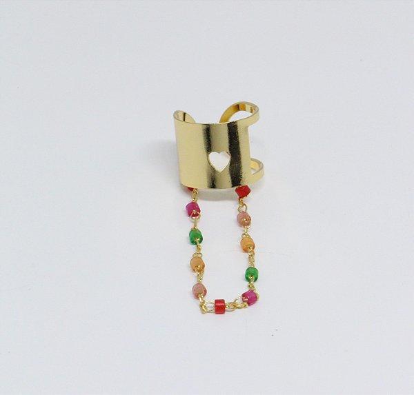 Piercing fake de chapa com coração vazado e corrente colorida pendurada