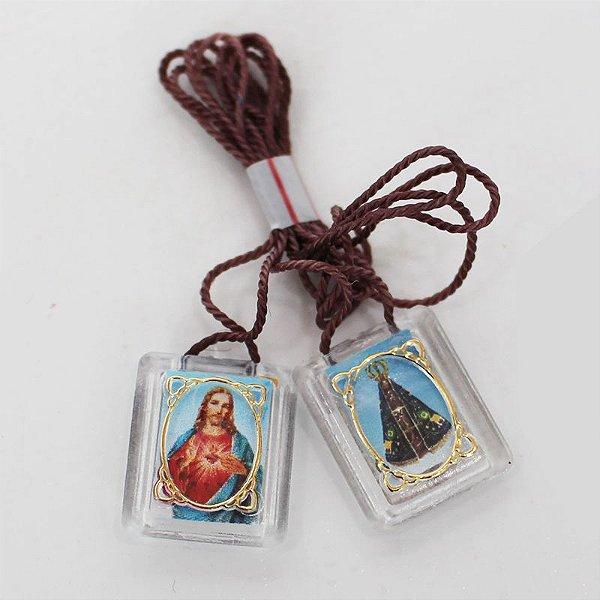 Escapulário em Acrílico - Sagrado Coração de Jesus e Nossa Senhora Aparecida - Pacote com 50 peças - Cód.: 1876