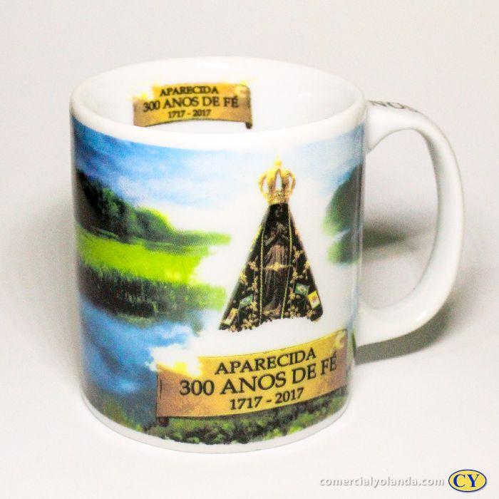 Caneca de porcelana dos 300 Anos de Nossa Senhora Aparecida - A Unidade - Cód.: 5068