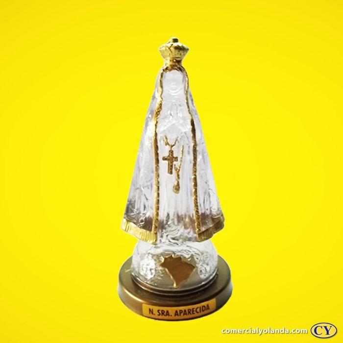 Imagem de Nossa Senhora Aparecida em plástico transparente, base cor ouro velho. - O Pacote com 3 peças - Ref.: IB.AP.65