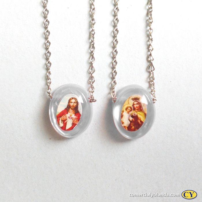 Escapulário em plastico madrepérola, Sagrado Coração de Jesus e Nossa Senhora do Carmo, corrente em aço inox - A Dúzia - Cód.: 6353