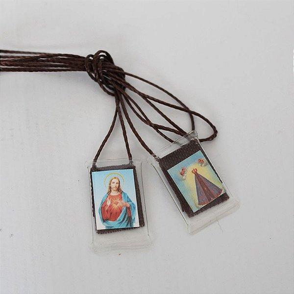Escapulário com cordão de nylon e foto plastificada, Sagrado Coração de Jesus e Nossa Senhora Aparecida - Pacote com 50 peças - Cód.: 1968