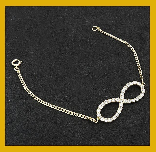 Pulseira banhada com simbolo do infinito em strass.