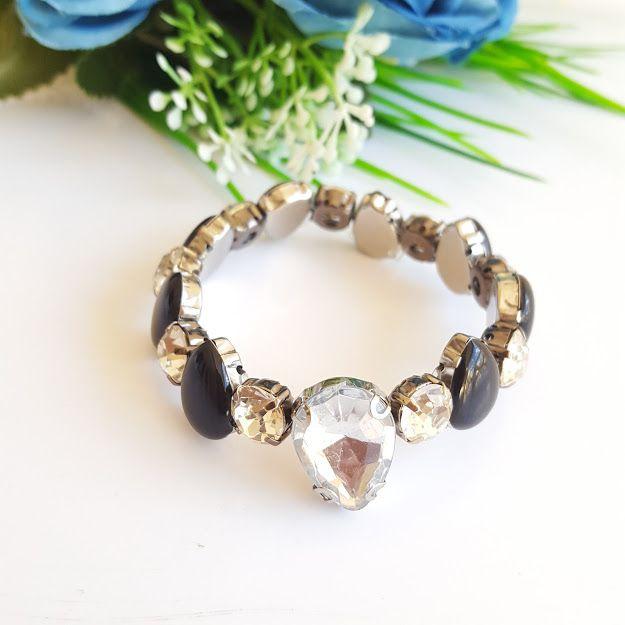 Pulseira com pedra preta e cristal gota