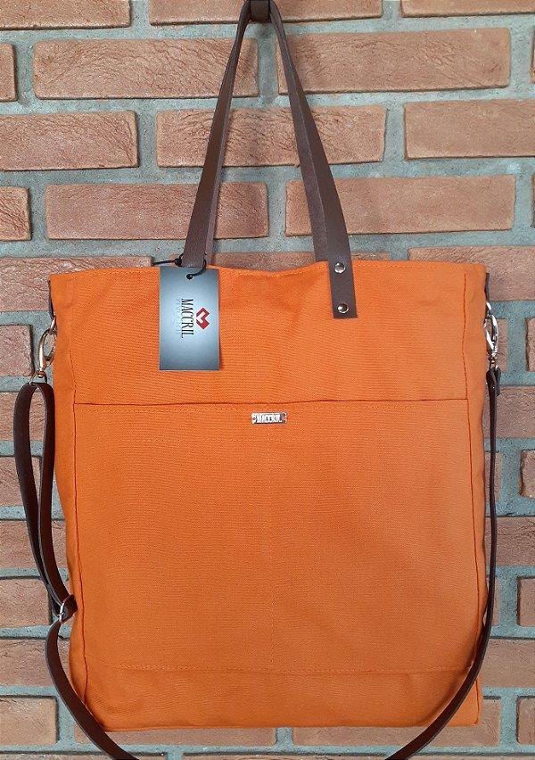 Bolsa de tecido feminina com alça de couro
