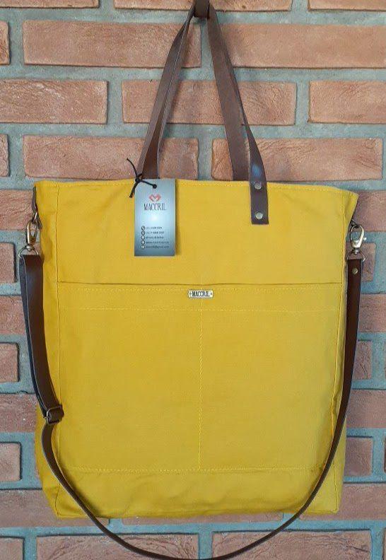 Bolsa maccril de tecido amarela com alças de couro